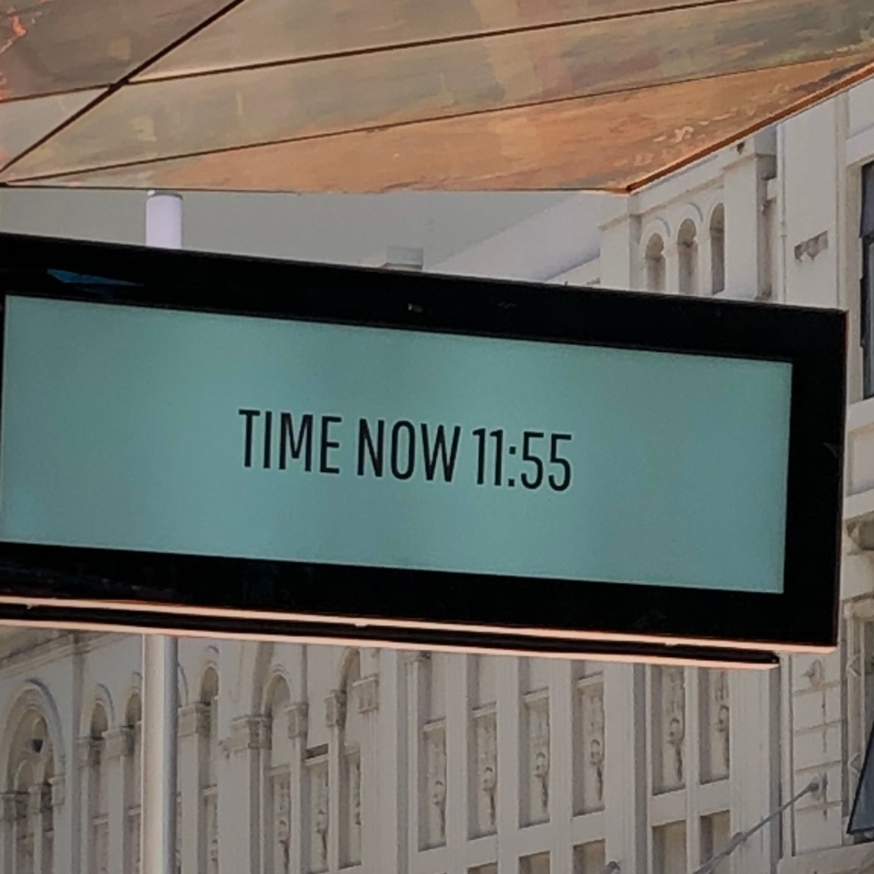 Clock that says the time is now 11:55