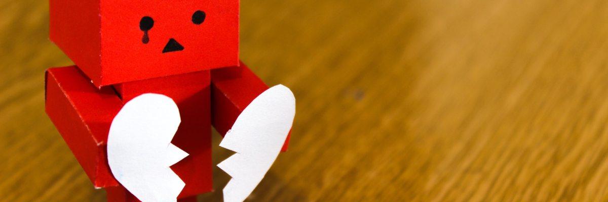 cardboard robot with broken heart