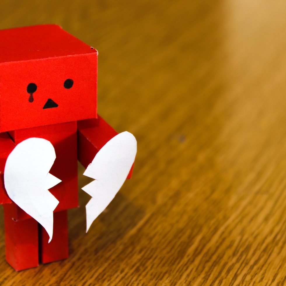 cardboard robot with broken heart